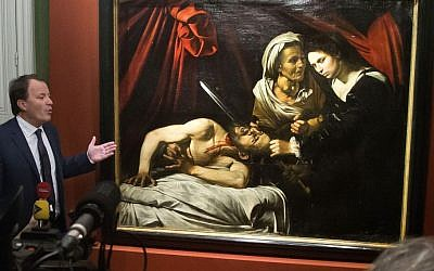 Auction officer Marc Labarbe presents 'Judith Beheading Holofernes' by Italian master Carvaggio in Paris, Tuesday, April 12, 2016. (AP/Michel Euler)