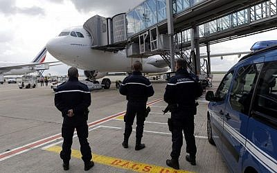 French Gendarme security forces stand guard next to the AF 738 Air France Airbus A330 for the Paris-Tehran inaugural flight at Roissy Charles De Gaulle Airport, north of Paris, France, April 17, 2016. (AP/Francois Mori)