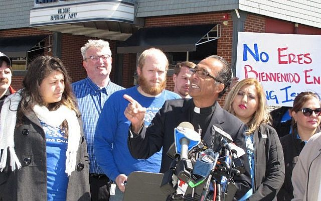 The Rev. Alan Ramirez, an adviser to the family of Marcelo Lucero, speaks at a press conference in Patchogue, NY, April, 13, 2016. (AP/Frank Eltman)