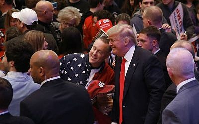 Republican presidential candidate Donald Trump poses for a photograph at a campaign event, Saturday, April 2, 2016, in Racine, Wisconsin. (AP Photo/Paul Sancya)