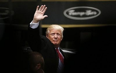 Republican presidential candidate Donald Trump acknowledges supporters while leaving Trump Tower on his way to visit the World Trade Center Museum in New York, April 9, 2016. (AP/Julio Cortez)