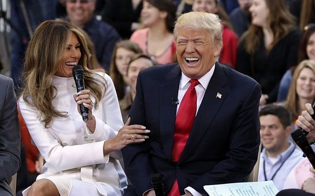 Republican presidential candidate Donald Trump reacts as his wife, Melania, answers a question during an interview on the NBC 'Today' television program in New York, April 21, 2016. (AP/Richard Drew)