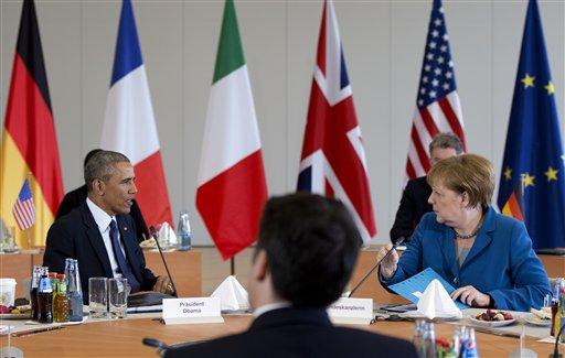 US President Barack Obama, Italian Prime Minister Matteo Renzi, and German Chancellor Angela Merkel, meet at Schloss Herrenhausen in Hannover, Germany, April 25, 2016. (AP Photo/Carolyn Kaster)