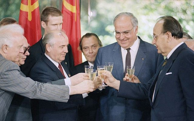 In this June 13, 1989 file photo Soviet and West German leaders clink glasses with champagne after signing a joint declaration of friendship and cooperation in Bonn's Chancellery. From left are Soviet Foreign Minister Eduard Shevardnadze, President Mikhail Gorbachev, West German Chancellor Helmut Kohl and West German Foreign Minister Hans-Dietrict Genscher. (AP Photo/Roberto Pfeil, file)