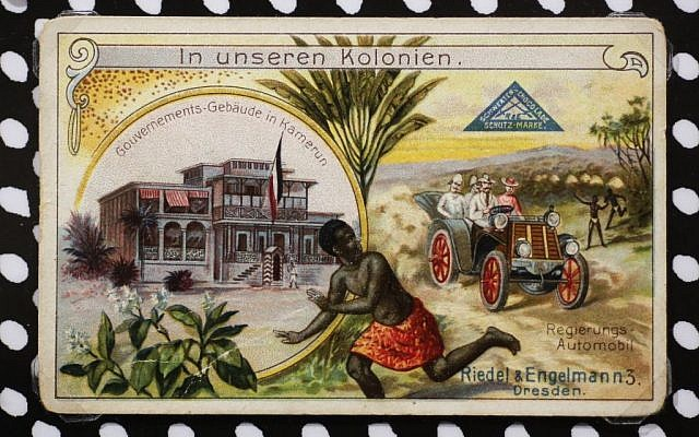 A colonial racist collectible stamp reading: 'In our colonies' displayed at an exhibition of antisemitic and racist stickers at the Deutsches Historisches Museum in Berlin, Germany, April 19, 2016. (AP Photo/Markus Schreiber)