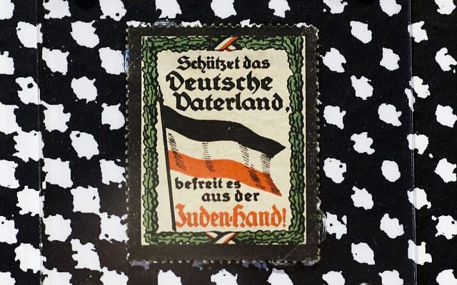 A sticker from around 1900 reading: 'Protect the German fatherland - liberate it from the Jewish hand!  displayed at an exhibition of antisemitic and racist stickers at the Deutsches Historisches Museum in Berlin, Germany, April 19, 2016. (AP Photo/Markus Schreiber)