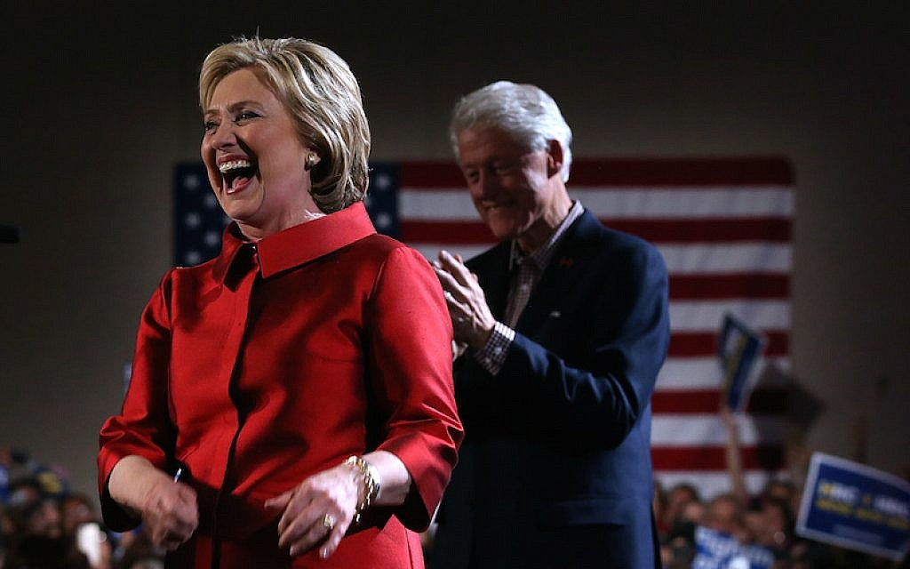 Hillary Clinton greeting supporters at a caucus day event as her husband, former president Bill Clinton, looks on at Caesars Palace in Las Vegas, Feb. 20, 2016. (Justin Sullivan/Getty Images/via JTA)