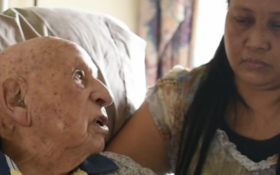 Holocaust survivor Richard Roberts being interviewed recently with his caregiver, Elenita Fernandez, in Sydney, Australia. (Screenshot via JTA)