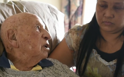 Holocaust survivor Richard Roberts being interviewed recently with his caregiver, Elenita Fernandez, in Sydney, Australian. (Screenshot via JTA)
