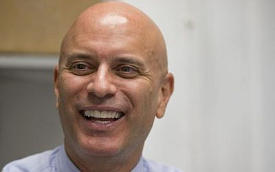 In this photo taken April 6, 2016, Tim Canova smiles as he speaks during an interview at his campaign headquarters in Hollywood, Florida. (AP Photo/Wilfredo Lee)