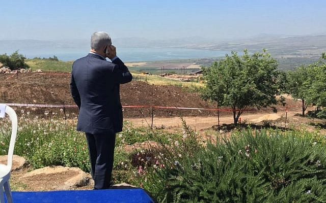 Prime Minister Benjamin Netanyahu speaks on the phone during a weekly cabinet meeting held on the Golan Heights, April 17, 2016. (Moav Vardi)