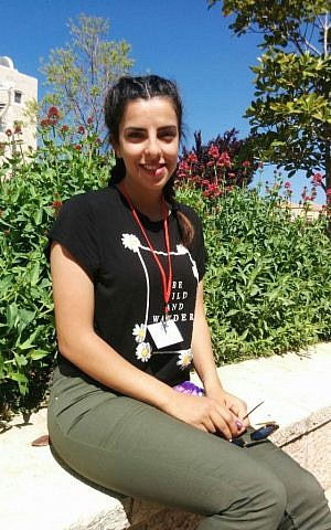 Duha Alma, 20, sits in Jerusalem YMCA courtyard on April 7th, where attended the ALLMEP conference. She is a player and coach in the Peace Players NGO that bring Israeli and Palestinian together through basketball. (Dov Lieber/Times of Israel)