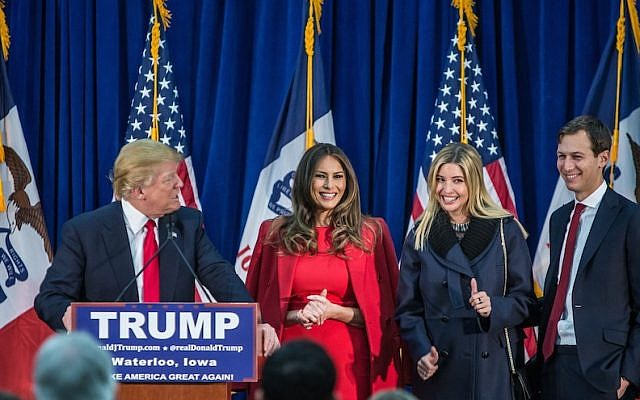 Republican presidential candidate Donald Trump standing on with his wife Melania Trump, daughter Ivanka Trump and son-in-law Jared Kushner (left to right) at a campaign rally at the Ramada Waterloo Hotel and Convention Center in Waterloo, Iowa, February 1, 2016. (Brendan Hoffman/Getty Images, via JTA)