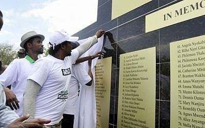 Students check names on the memorial plaque at Garissa University, in Garissa, Kenya, Saturday, April 2, 2016. (AP Photo/Kevin Midigo)