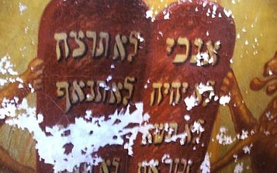 This image shows the extent of damage to the Ten Commandments. (Courtesy/Lost Shul Mural Project)