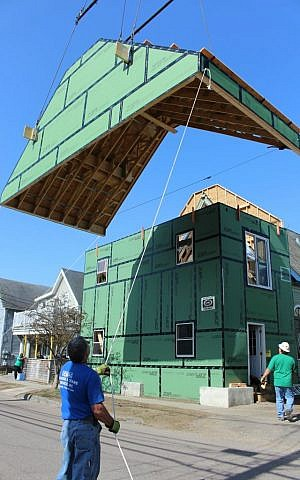 The artificial roof is hoisted by crane as engineers move the mural, 2015 (Courtesy)