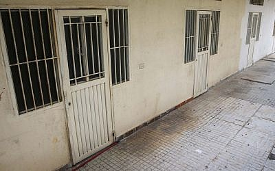 This Thursday April 7, 2016 photo shows barred rooms of the Chez Maurice Hotel in Beirut, where Lebanese security forces busted a sex trafficking ring involving 75 Syrian refugee women forced into prostitution. (AP Photo/Hussein Malla)