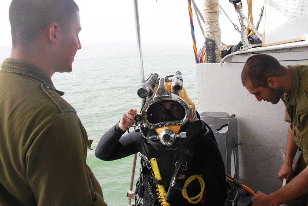 Cpl. Sahar Nitzan checks his gear before jumping into the Sea of Galilee on April 6, 2016, to search for missing pilot Lt. Yakir Naveh, whose plane crashed in 1962 (Judah Ari Gross/Times of Israel)