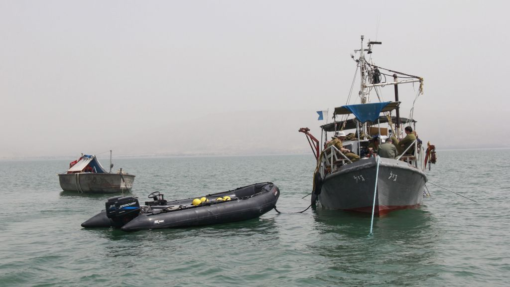 The navy uses three boats -- two civilian and one military -- to search, on April 6, 2016, for missing pilot Lt. Yakir Naveh, whose plane crashed in the Sea of Galilee in 1962 (Judah Ari Gross/Times of Israel)