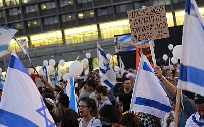 Protesters gather in Tel Aviv's Rabin Square in support of a soldier on trial for killing a Palestinian attacker in March who was incapacitated, on April 19, 2016. (Judah Ari Gross/Times of Israel staff)