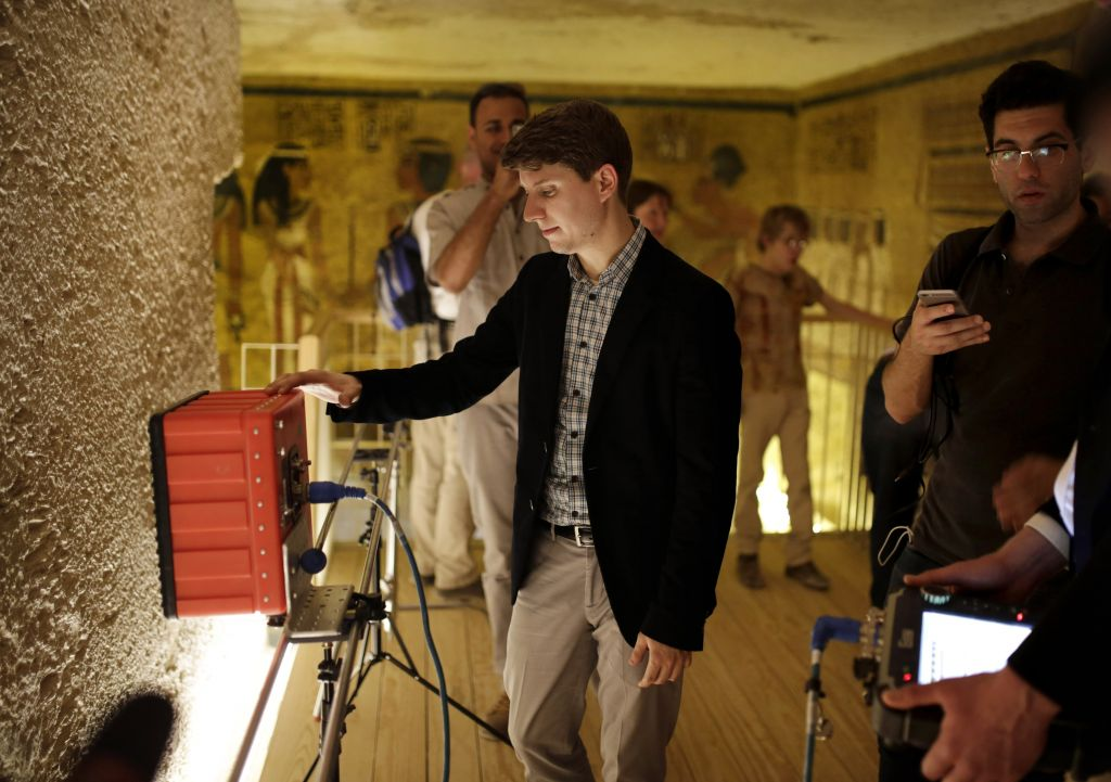Radar scanning experts scan a wall at King Tutankhamun's burial chamber at his tomb at the Valley of the Kings in Luxor, Egypt, Friday, April 1, 2016. Egypt's archaeologists have completed more extensive scanning of two recently discovered chambers behind King Tut's tomb in the Valley of the Kings. (AP Photo/Amr Nabil)