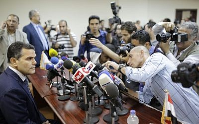 Egypt's Deputy Public Prosecutor Mustafa Suleiman, who headed an Egyptian delegation that was in Rome last week, as he prepares to speak during a press conference on slain Italian graduate student Giulio Regeni, April 9, 2016. (AP Photo/Amr Nabil)