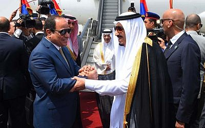 In this picture provided by the office of the Egyptian Presidency, Egyptian President Abdel-Fattah el-Sissi, left, shakes hands with Saudi Arabia's King Salman before he departs Egypt, Monday, April 11, 2016.  (Sherif Abdel Minoem, Egyptian Presidency via AP)