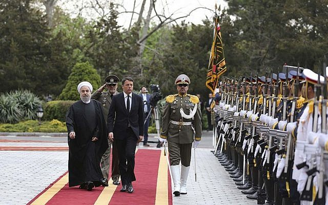Italian Prime Minister Matteo Renzi reviews an honor guard as he is accompanied by Iran's President Hassan Rouhani during his official arrival ceremony at the Saadabad Palace in Tehran, Iran, Tuesday, April 12, 2016. (Iranian Presidency Office via AP)