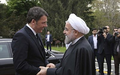 Iran's President Hassan Rouhani welcomes Italian Prime Minister Matteo Renzi during an official arrival ceremony at the Saadabad Palace in Tehran, Iran, April 12, 2016. (Iranian Presidency Office via AP)