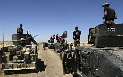 Iraqi security forces prepare to attack Islamic State group positions in Hit, 85 miles (140 kilometers) west of Baghdad, Iraq, Saturday, April 2, 2016. (AP Photo/Khalid Mohammed)