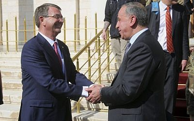 US Defense Secretary Ash Carter is greeted by Lt. Gen. Sean MacFarland, the top US Commander for the fight against the Islamic State group in Iraq and Syria, in Baghdad on April 18, 2016. (AP Photo/Lolita C. Baldor)
