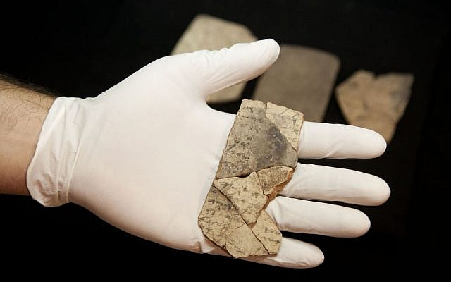 Letters inscribed on pottery, known as ostraca, which were unearthed in an excavation of a fort in Arad, Israel, and dated to about 600 BCE shortly before Nebuchadnezzar's destruction of Jerusalem, are seen in Israel Museum in Jerusalem Tuesday, April 12, 2016. (AP Photo/Dan Balilty)
