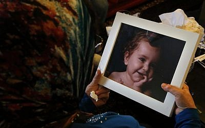 Lebanese Ibtissam Berri holds a picture of her granddaughter Lahela al-Amin as she speaks during an interview with The Associated Press, at her home in the southern suburbs of Beirut, Lebanon, Thursday, April 7, 2016. (AP Photo/Bilal Hussein)