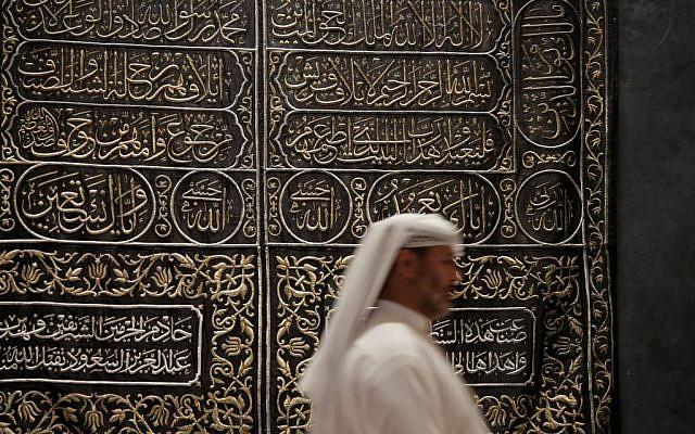 In this photo taken on April 16, 2015, A Saudi man walks next to Kaaba door curtain at Riyadh National Museum in Riyadh, Saudi Arabia. (AP Photo/Hasan Jamali)