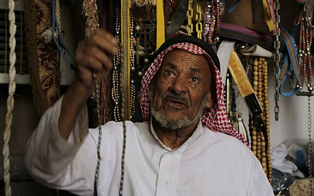 In this photo taken on April. 22, 2015, A Saudi vendor displays beads to customers at a market in Najran, Saudi Arabia. (AP Photo/Hasan Jamali)