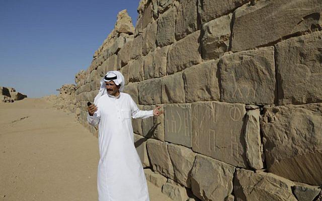 In this photo taken on April. 22, 2015, A Saudi man stands at al-Ukhdood archeological site in Najran, Saudi Arabia.(AP Photo/Hasan Jamali)