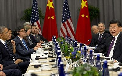 President Barack Obama listens at left as Chinese President Xi Jinping speaks during their meeting at the Nuclear Security Summit in Washington, Thursday, March 31, 2016. (Jacquelyn Martin/AP)