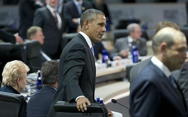 President Barack Obama takes his seat with other world leaders for the afternoon plenary session of the Nuclear Security Summit, Friday, April 1, 2016, in Washington. (AP/Alex Brandon)