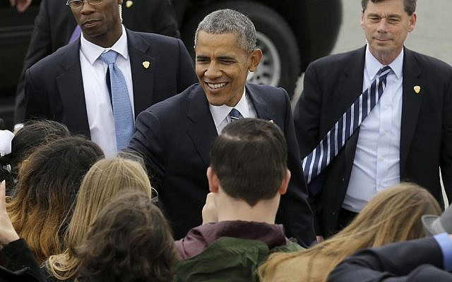 President Barack Obama smiles as he greets supporters after arriving on Air Force One at San Francisco International Airport in San Francisco, Friday, April 8, 2016. (AP Photo/Jeff Chiu)