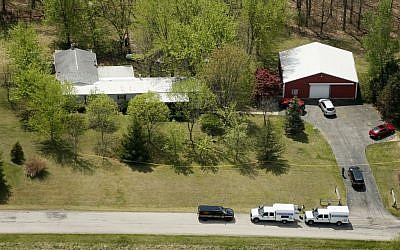 This aerial photo shows one of the locations being investigated in Pike County, Ohio, as part of an ongoing homicide investigation, Friday, April 22, 2016.  (Lisa Marie Miller/The Columbus Dispatch via AP)