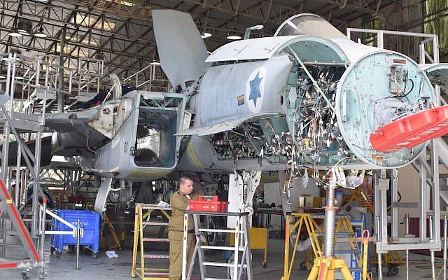 An IAF airman works on an F-15 at the Air Forces' AMU (IAF)