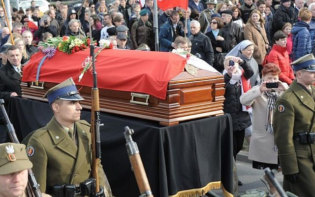 Polish Army soldiers walk next to the coffin with the remains of Zygmunt Szendzielarz during his funeral in Warsaw, Poland, Sunday, April 24, 2016. Polish President Andrzej Duda and government ministers have taken part in the state burial of Szendzielarz, a World War II resistance commander and communist regime victim whose remains were found in a hidden mass grave. (AP/Alik Keplicz)