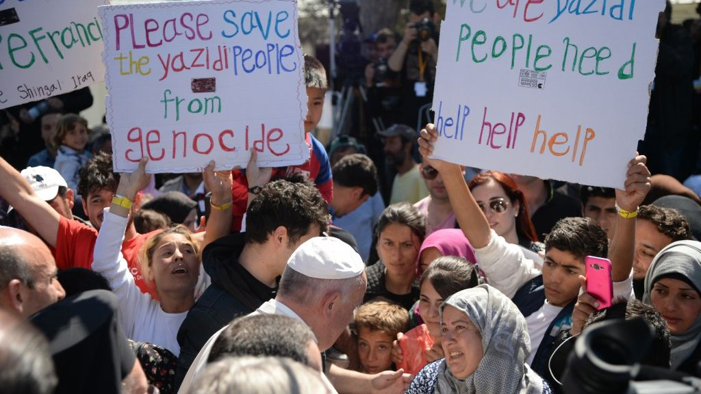 Pope Francis greets migrants and refugees at the Moria refugee camp, on the Greek island of Lesbos, Saturday, April 16, 2016. (Filippo Monteforte/Pool Photo via AP)