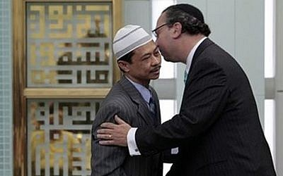 Rabbi Marc Schneier, right, scene with Imam Shamsi Ali, said he is leaving his Westhampton Beach synagogue in part to focus on Muslim-Jewish relations. (Richard Drew/AP)