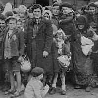 Jewish women and children from Subcarpathian Rus await selection on the ramp at Auschwitz-Birkenau, May 1944. (United States Holocaust Memorial Museum, courtesy of Yad Vashem)
