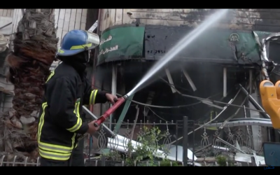 Palestinian firefighters extinguish a blaze at a Ramallah money exchange, which began when soldiers attempted to open a safe using a small detonator, on April 14, 2016. (Screen capture: YouTube)