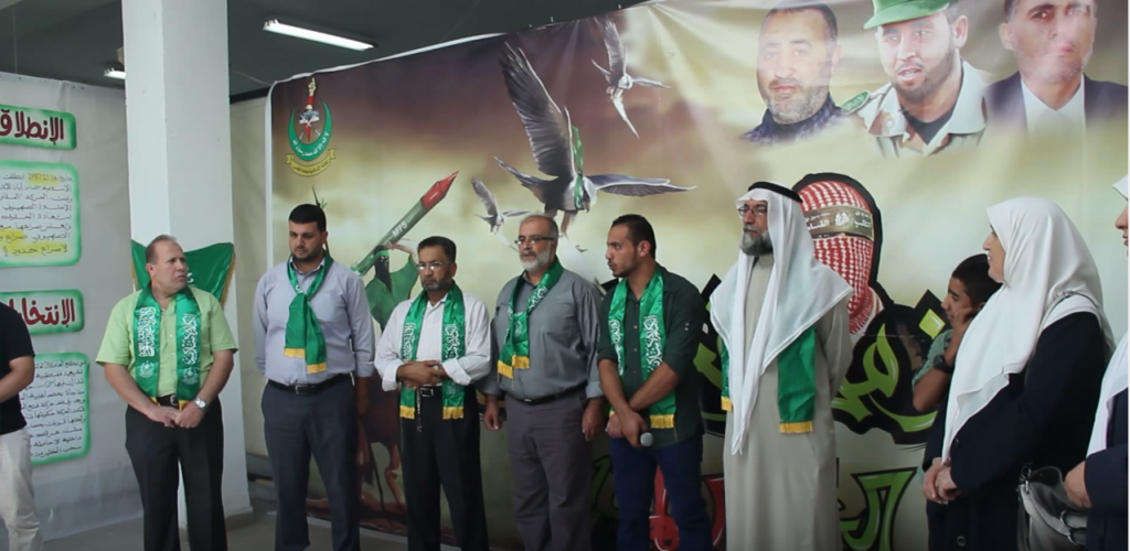 Imad Barghouti (far left) speaks at a Hamas rally at al-Quds University in Jerusalem in October 2014. (screen capture: YouTube)