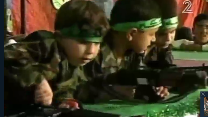 Young Palestinian boys hold toy guns in a play held in Gaza as part of the 'Palestine Festival for Children and Education,' April 2016 (Channel 2 news)