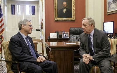 Judge Merrick Garland, President Barack Obama's choice to replace the late Justice Antonin Scalia on the Supreme Court, meets with Senate Minority Whip Richard Durbin of Illinois, a member of the Senate Judiciary Committee which considers nominations to the high court, Wednesday, April 6, 2016, on Capitol Hill in Washington. (AP Photo/J. Scott Applewhite)