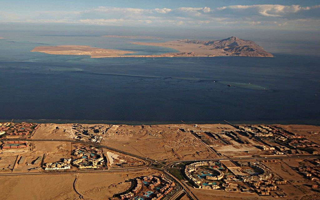 The Red Sea islands of Tiran, in the foreground, and Sanafir, in the background, sit at the the Strait of Tiran between Egypt's Sinai Peninsula and Saudi Arabia (Stringer/AFP/Getty Images, via JTA)